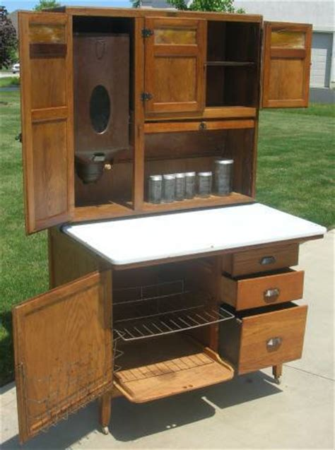 wilson kitchen cabinet hoosier oak hoosier wilson kitchen cabinet with slag glass doors flour bin glassware ebay
