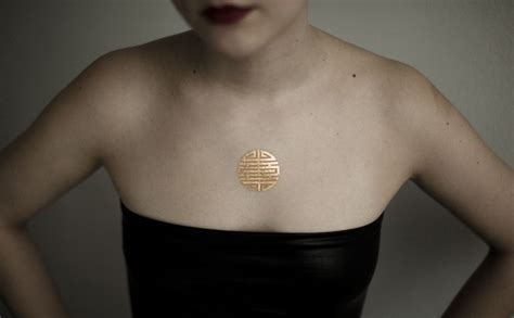24 karat gold tattoo onlyjewels