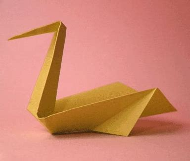 Origami Twirling Bird - yellow pelican schemes of origami from paper