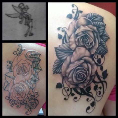 white ink tattoo rose by jojo miller cover up of tinkerbell roses