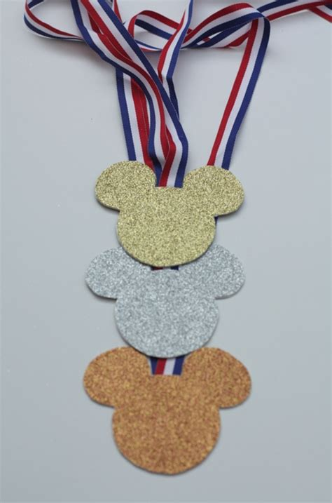 a medal with mouse ears one s journey to running the walt disney world marathon books celebrate the olympics with mickey medals this
