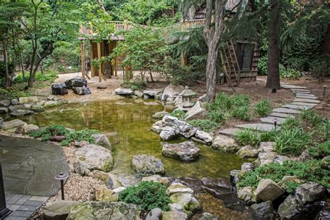 backyard nature natural playscapes pond and playground oasis in city backyard
