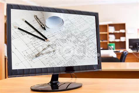 tools for drawing on computer computer monitor with blueprints and drawing tools on