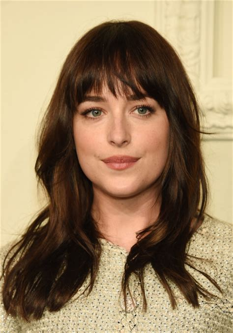 dakota johnson bangs dakota johnson long wavy cut with bangs lookbook stylebistro