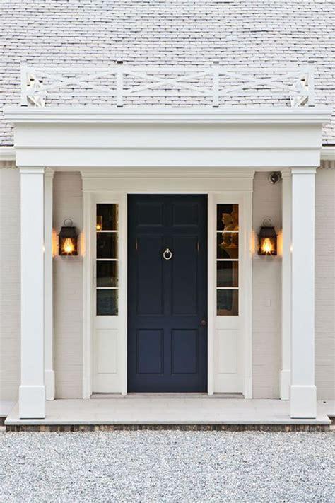 navy blue front door white brick navy door rail above architecture