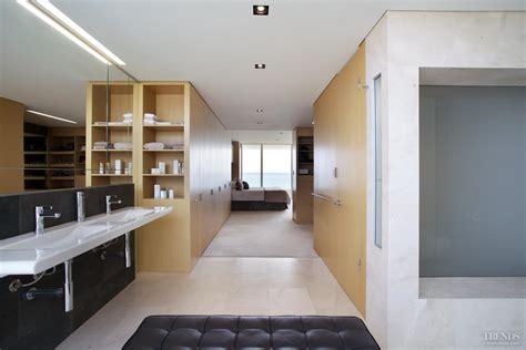 Master suite design integrates bedroom closet dressing area and bathroom