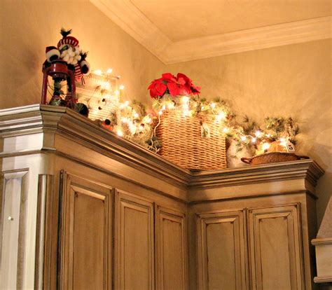 christmas decorations on kitchen cabinets at rivercrest cottage putting away
