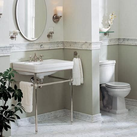 how to make a small bathroom work a small protrsusion or tiled half wall can add basic