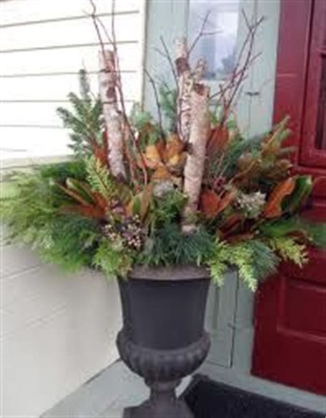 christmas urn designs 1000 images about urns on urns outdoor and urn planters