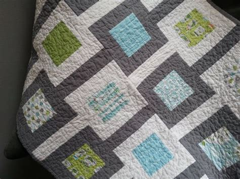 Handmade Baby Quilt Patterns - handmade baby quilt with a modern square design in blues