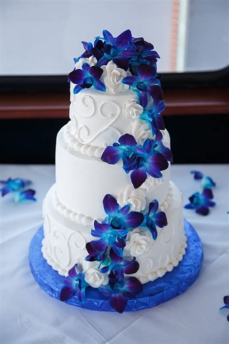 Wedding White Cake by White Wedding Cake With Swirls And Blue Orchid