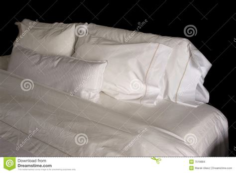 hotel bed pillows pillows on a hotel bed stock images image 7519884