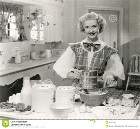 domestic goddess baking in the kitchen stock photo image