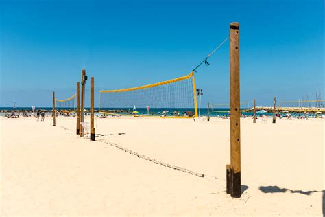 how to make a beach volleyball court in your backyard here are the standard dimensions of a beach volleyball court