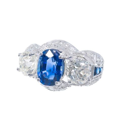 cornflower blue oval sapphire platinum engagement