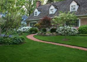 An Entry With A Beautiful Lawn And Colorful Garden
