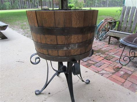 whiskey barrel bench 1000 ideas about whiskey barrel planter on pinterest
