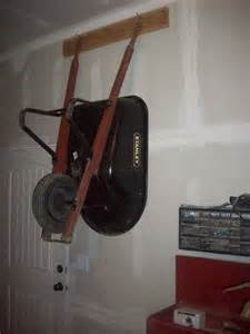 hanging a picture hangin a wheelbarrow on the wall cheaply and conveniently