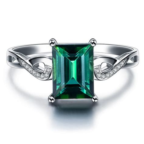 unique 1 50 carat emerald and infinity engagement