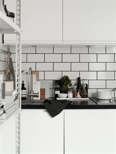 kitchen details white tiles black grout