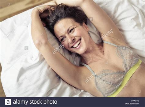 wearing bra to bed overhead view of mature woman wearing bra lying on bed