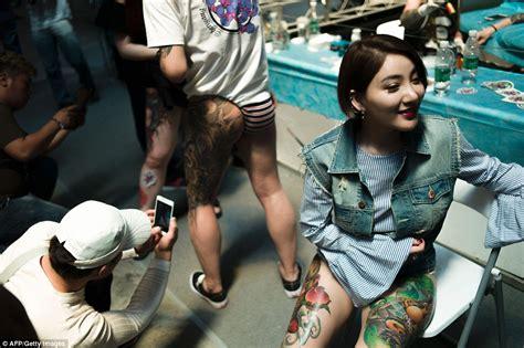 tattoo girl show nbc chinese men and women at langfang international tattoo