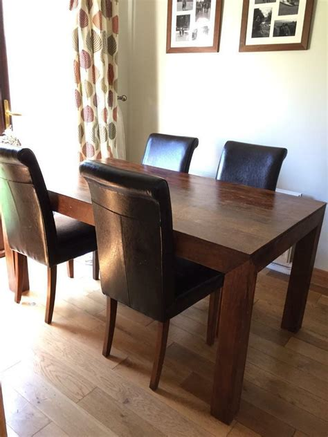 reduced mango wood dining table chairs in swindon