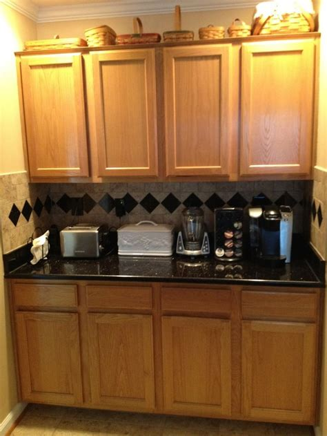 oak woodwork llc black granite countertops with oak cabinets granite