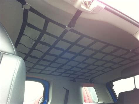 roof upholstery interior roof cargo net cleaver way to store stuff for