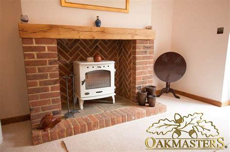 Oak Beam For Fireplace by Modern Brick Fireplace With Oak Mantle Beam Oakmasters