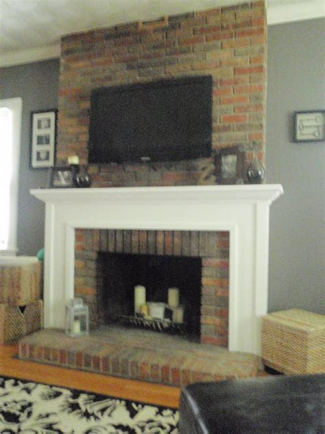 updating a brick wall and high heels living room mounting a tv to a brick fireplace