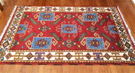 indian throw rugs vibrant knotted indian throw rug in crimson turquoise green and beige epoch