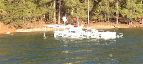 houseboats on lake lanier illegally beached houseboat is polluting lake lanier