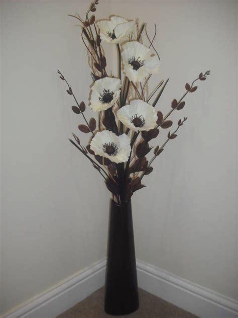 cream silk flower arrangement brown vase  metre tall