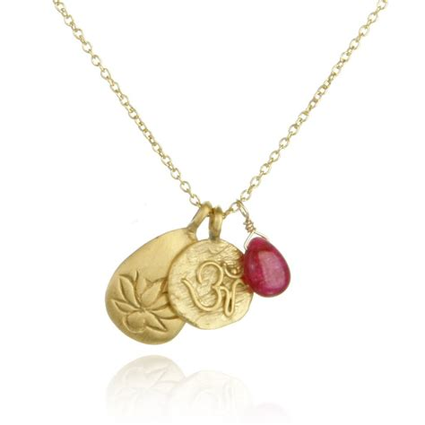 gold ruby om and lotus necklace roots of satya