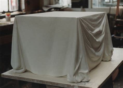 draped cloth bespoke carving a stone plinth carved to look like