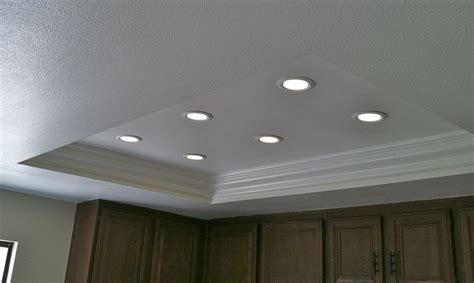 ..the same kitchen lighting AFTER, with new crown molding