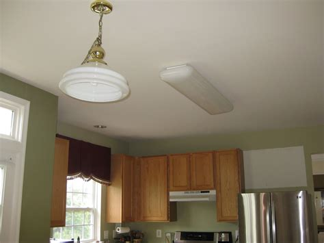 How To Install Kitchen Light Fixture Remodelando La Casa Thinking About Installing Recessed Lights