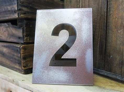 metal table numbers