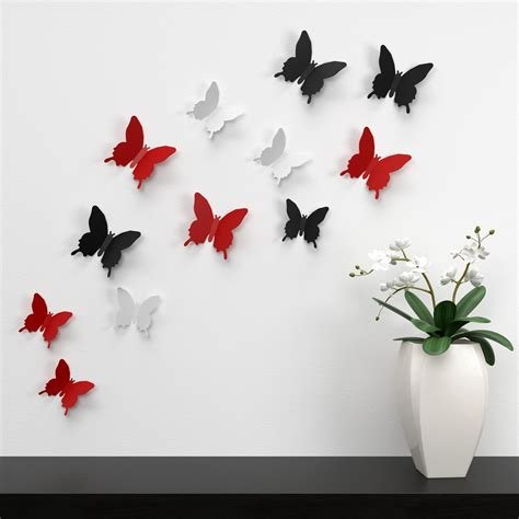 white black and butterflies wall decor near white
