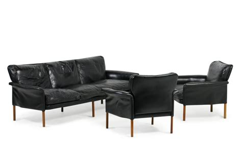 one of two leather and teak 1960s lounge sofa with