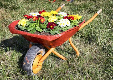 Large Wooden Wheelbarrow Planter by 27 Wheelbarrow Flower Planter Ideas For Your Yard