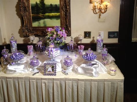 lavender white candy table for a sweet 16 candy