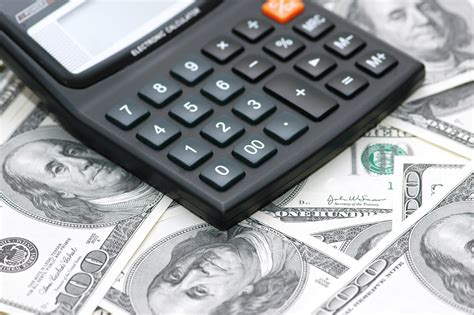 calculator dollar accounting calculator over the hundred dollar bank notes