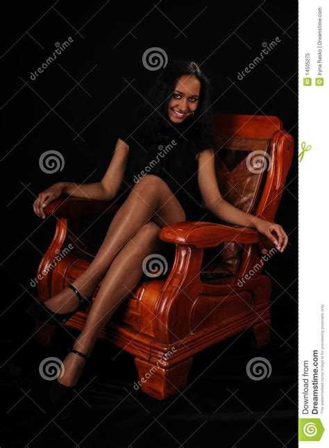 woman in armchair attractive young woman in armchair royalty free stock