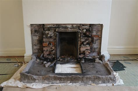 hammer brush removing a tiled fireplace part 2