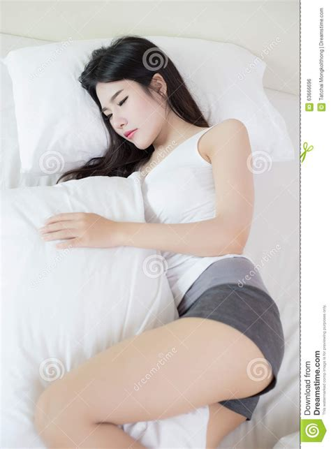 what are chinese women like in bed young beautiful woman sleeping on bed stock photo image