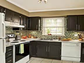 what color to paint kitchen cabinets with black appliances brown painted kitchen cabinets your home