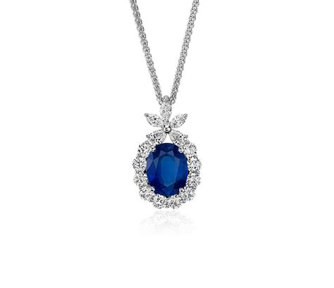 oval sapphire and pendant in 18k white gold 9x7mm