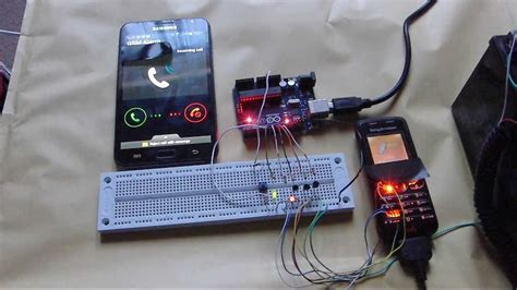 hacked phone arduino gsm auto dialler  schematic